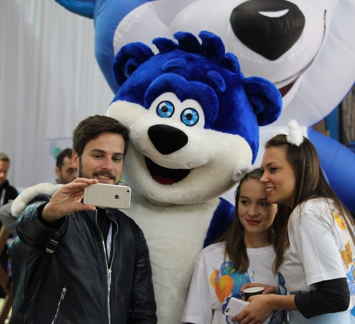 Attendee taking a selfie in the exhibition area of startup conference 4YFN 2018 Barcelona